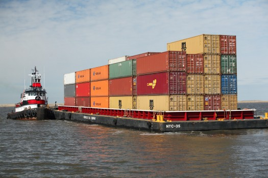 A shipping vessel loaded with colorful shipping containers.